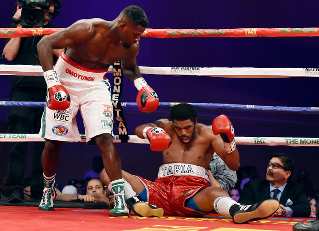 Andrew Tabiti, left, of Las Vegas looks down on Keith Tapia of New York after Tapia fell on the ropes during a cruiserweight fight at Sam's Town hotel-casino Friday, May 13, 2016, in Las Vegas. Ta ...
