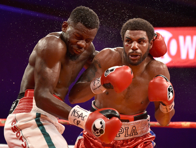 Andrew Tabiti, left, of Las Vegas and Keith Tapia of New York battle it out during a cruiserweight fight at Sam's Town hotel-casino Friday, May 13, 2016, in Las Vegas. Tabiti won by a unanimous de ...