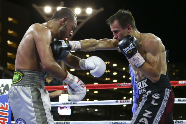 Petr Petrov, right, lands a punch against Marvin Quintero during their lightweight fight at Toshiba Plaza, adjacent to the T-Mobile Arena, in Las Vegas on Friday, May 6, 2016. Petrov won at the en ...
