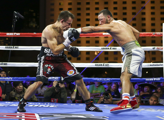 Marvin Quintero, right, connects a left against Petr Petrov during their lightweight fight at Toshiba Plaza, adjacent to the T-Mobile Arena, in Las Vegas on Friday, May 6, 2016. Petrov won at the  ...