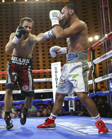 Petr Petrov, left, throws a punch against Marvin Quintero during their lightweight fight at Toshiba Plaza, adjacent to the T-Mobile Arena, in Las Vegas on Friday, May 6, 2016. Petrov won at the en ...