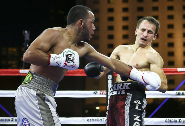 Marvin Quintero, left, fights Petr Petrov during their lightweight fight at Toshiba Plaza, adjacent to the T-Mobile Arena, in Las Vegas on Friday, May 6, 2016. Petrov won at the end of round 6 wit ...