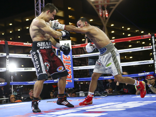 Marvin Quintero, right, lands a left against Petr Petrov during their lightweight fight at Toshiba Plaza, adjacent to the T-Mobile Arena, in Las Vegas on Friday, May 6, 2016. Petrov won at the end ...