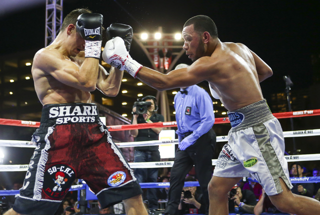 Petr Petrov, left, blocks a left from Marvin Quintero during their lightweight fight at Toshiba Plaza, adjacent to the T-Mobile Arena, in Las Vegas on Friday, May 6, 2016. Petrov won at the end of ...
