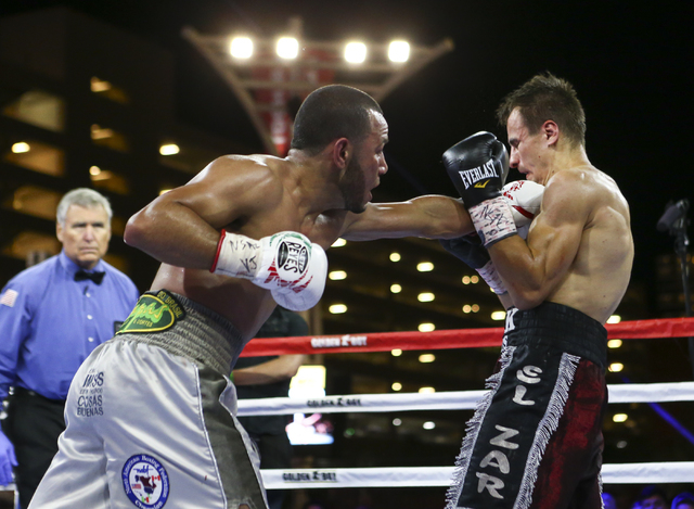 Marvin Quintero, left, lands a punch against Petr Petrov during their lightweight fight at Toshiba Plaza, adjacent to the T-Mobile Arena, in Las Vegas on Friday, May 6, 2016. Petrov won at the end ...