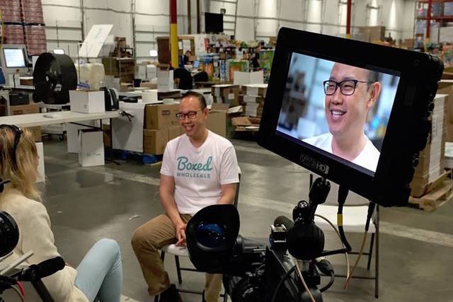 Boxed CEO Chieh Huang is seen at one of the company's fulfillment centers. (Boxed Wholesale/Facebook)