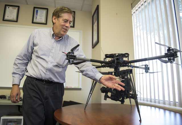 Ron Futrell, media relations for ArrowData, talks about the Cinestar X8 drone in their offices at 777 N. Rainbow Ave. in Las Vegas on Wednesday, May 6, 2015. (Martin S. Fuentes/Las Vegas Review-Jo ...