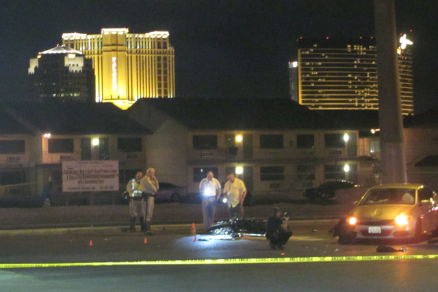 Investigators examine the scene where a motorcycle and a car collided on Swenson Street north of Flamingo Road on Wednesday, May 18, 2016. The motorcyclist died in the crash. (Greg Haas/Las Vegas  ...