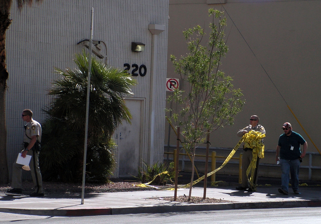 Police begin to clear the scene near 3rd Street and Ogden Street after a four people were shot in downtown Las Vegas on Sunday, May 29, 2016. Police closed off several blocks during the investigat ...