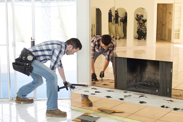 Jonathan Scott during demolition of the living room, as seen on Brother vs Brother. (Courtesy HGTV)