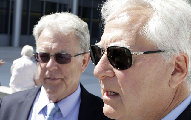 Washington attorney Larry Klayman, right, and Cliven Bundy's attorney Joel Hansen address the media outside Lloyd George U.S. Courthouse on Wednesday, May 25, 2016. Chief U.S. District Judge Glori ...