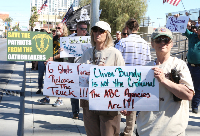 Terry Noonkester, right, and Jane Doherty, second right, protest outside Lloyd George Federal Building on Thursday, March 10, 2016, in Las Vegas. Cliven Bundy appears in court this afternoon. Bizu ...