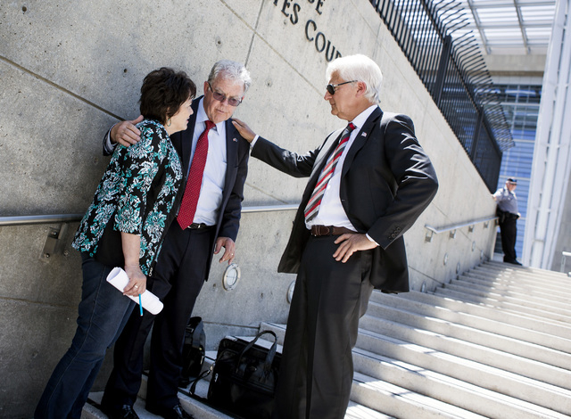 Attorneys Larry Klaymam, right, and Joel Hansen talks to Carol Bundy, wife of Nevada rancher Cliven Bundy, in front of Lloyd George U.S. Courthouse after filing a lawsuit  against President Barack ...