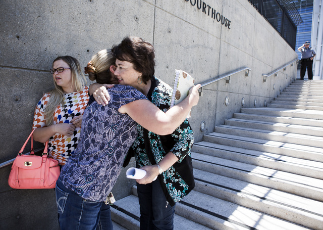 Carol Bundy, wife of Nevada rancher Cliven Bundy, hugs a family member in front of Lloyd George U.S. Courthouse on Tuesday, May 10, 2016. Jeff Scheid/Las Vegas Review-Journal Follow @jlscheid