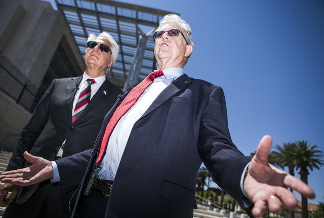 Attorneys Larry Klaymam, left, Joel Hansen, representing Nevada rancher Cliven Bundy, talks to the media in front of Lloyd George U.S. Courthouse after filing a lawsuit  against President Barack O ...