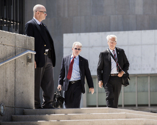 Attorneys Joel Hansen, center, and Larry Klaymam, right, representing Nevada rancher Cliven Bundy, walk outside Lloyd George U.S. Courthouse after filing a lawsuit  against President Barack Obama, ...