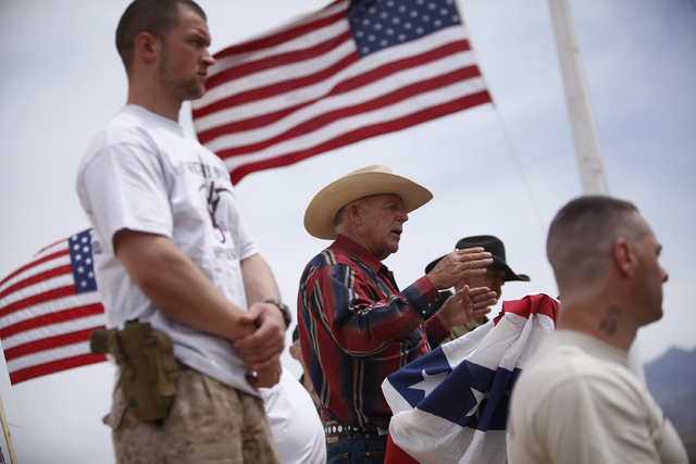 Flanked by armed supporters, Cliven Bundy speaks at a protest camp near Bunkerville, Nev. Friday, April 18, 2014. (John Locher/Las Vegas Review-Journal)