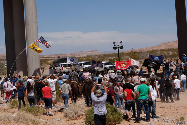 The Bundy family and their supporters gather together under Interstate 15 just outside of Bunkerville in order to confront the BLM and demand the release of their impounded cattle on April 12, 201 ...