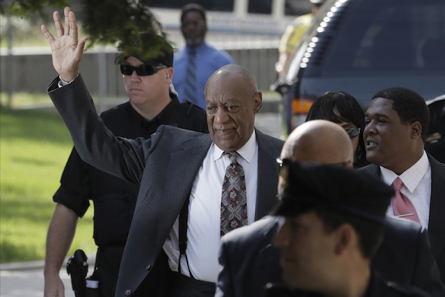 Bill Cosby waves to supporters as arrives at the Montgomery County Courthouse for a preliminary hearing, Tuesday, May 24, 2016, in Norristown, Pa. Cosby is accused of drugging and molesting a woma ...