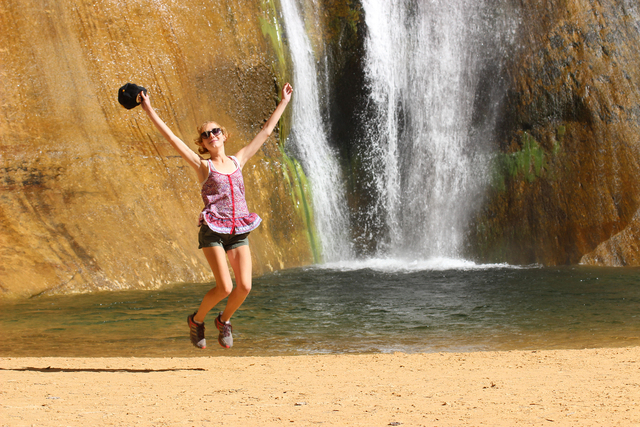 The author's daughter, Charlotte Wall, enjoys the sandy beach surrounding the pool at the base of Lower Calf Creek Falls. The pool is ideal for wading and cooling off on a spring day. Deborah Wa ...