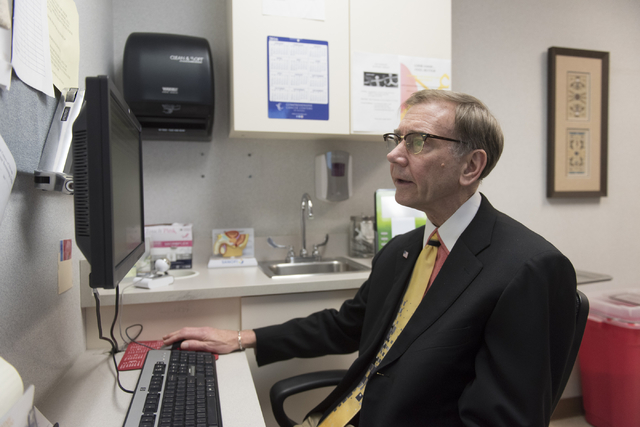 Dr. Nicholas Vogelzang works on his computer as he speaks with a reporter at Comprehensive Cancer Centers of Nevada at 3730 S. Eastern Ave. in Las Vegas Friday, May 20, 2016. Jason Ogulnik/Las Veg ...