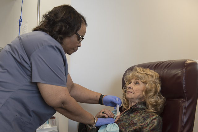 Registered nurse, Denise Hardy, left, prepares to give J Carole Kuntz, 74, Tecentriq for her bladder cancer at Comprehensive Cancer Centers of Nevada at 3730 S. Eastern Ave. in Las Vegas Friday, M ...