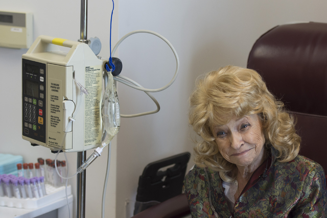 J Carole Kuntz, 74, smiles as she receives Tecentriq for her bladder cancer at Comprehensive Cancer Centers of Nevada at 3730 S. Eastern Ave. in Las Vegas Friday, May 20, 2016. Kuntz is the first  ...
