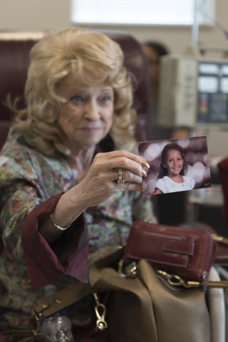 J Carole Kuntz, 74, shows a photograph of her granddaughter as she receives Tecentriq for her bladder cancer at Comprehensive Cancer Centers of Nevada at 3730 S. Eastern Ave. in Las Vegas Friday,  ...