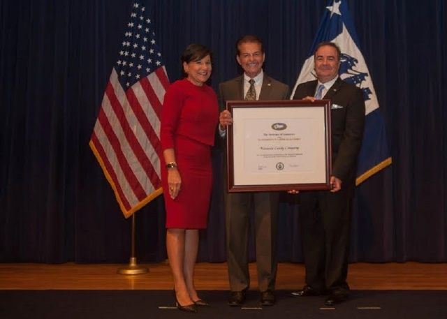 U.S. Secretary of Commerce Penny Pritzker, left, Joseph Dutra, Alvaro Tomas at an awards ceremony Monday in Washington, D.C. Both Dutra and Tomas are part of Kimmie Candy. Tomas is a business part ...