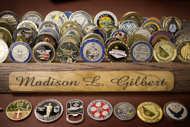 A selection of challenge coins is seen Wednesday, April 27, 2016 on Capt. Madison Gilbert's desk.  She is officer in charge at the 757th Aircraft Maintenance Squadron. (Jeff Scheid/Las Vegas Revie ...