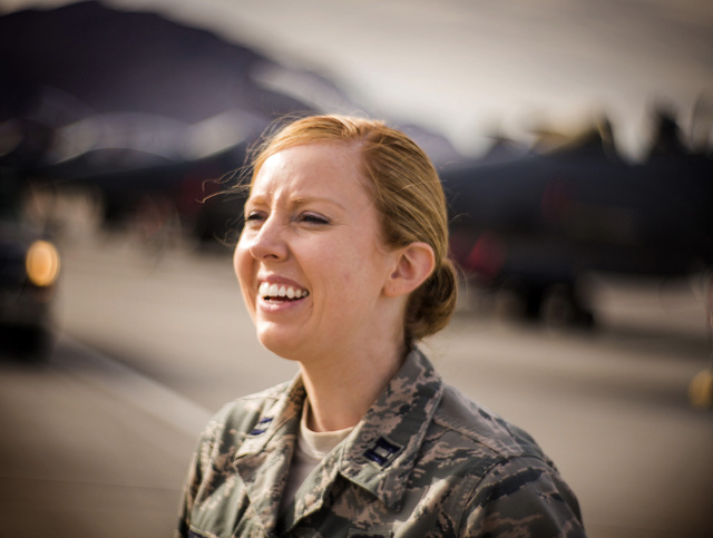 Capt. Madison Gilbert, officer in charge at the 757th Aircraft Maintenance Squadron, stands near a row of F-15E Strike Eagles on Wednesday, April 27, 2016.  (Jeff Scheid/Las Vegas Review-Journal)  ...