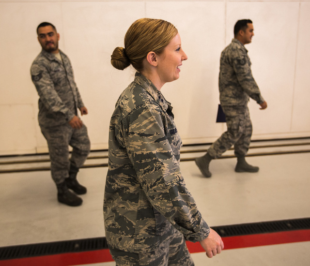 Capt. Madison Gilbert, officer in charge at the 757th Aircraft Maintenance Squadron, walks in the hanger  on Wednesday, April 27, 2016. (Jeff Scheid/Las Vegas Review-Journal) Follow @jlscheid