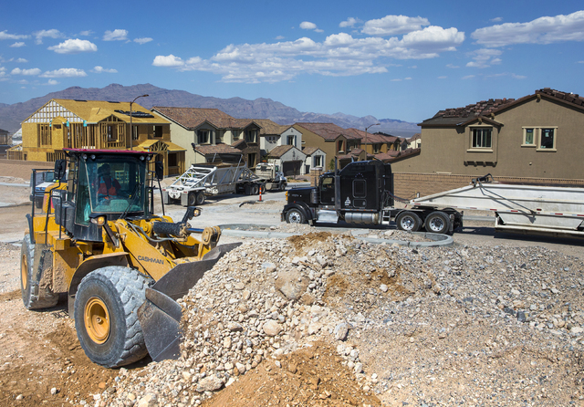 Construction workers clear space for an empty lot in the newly-developed Skye Canyon community, Monday, May 23, 2016, in Las Vegas. Benjamin Hager/Las Vegas Review-Journal