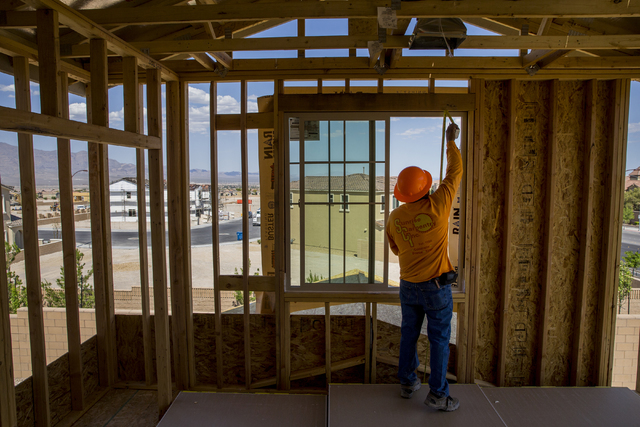 Jose Juarez measures a wall panel in a three-story home being constructed in the newly-developed Skye Canyon community, Monday, May 23, 2016, in Las Vegas. Benjamin Hager/Las Vegas Review-Journal