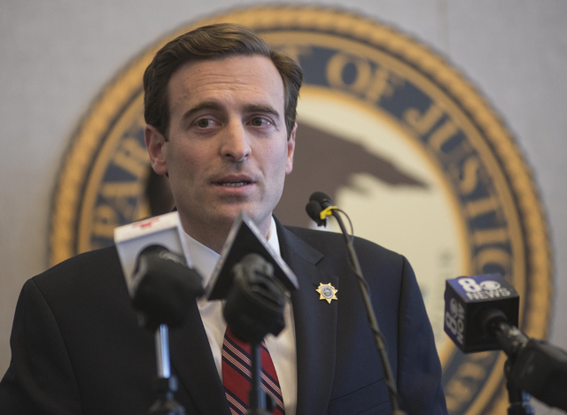 Adam Laxalt, Nevada Attorney General, speaks during a news conference on Thursday, Feb. 12, 2015, at the Lloyd D. George Federal Courthouse in Las Vegas to discuss ongoing efforts to prevent the s ...