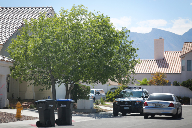 Metro police vehicles sit on the 8100 block of Villa Finestra Drive, where police received a call about an unresponsive child on Friday, May 13, 2016 in Las Vegas. The 3-year-old was taken to Moun ...