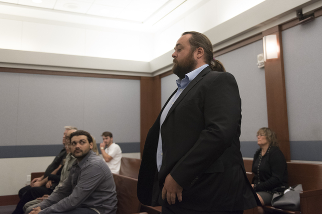 "Austin Lee ""Chumlee"" Russell approaches Judge Joseph S. Sciscento in court at the Regional Justice Center in Las Vegas Monday, May 23, 2016. The reality TV actor from ""Pawn Stars"" is facing gun an ..."
