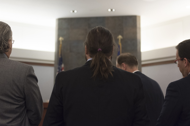 "Austin Lee ""Chumlee"" Russell, center, stands before Judge Joseph S. Sciscento with his attorneys in court at the Regional Justice Center in Las Vegas Monday, May 23, 2016. The re ..."