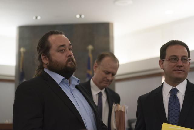 "Austin Lee ""Chumlee"" Russell, left, exits his courtroom at the Regional Justice Center in Las Vegas Monday, May 23, 2016. The reality TV actor from ""Pawn Stars"" ..."