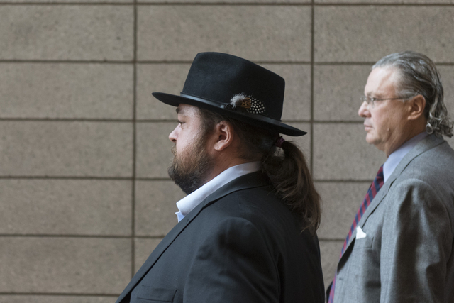 "Austin Lee ""Chumlee"" Russell, left, and his attorney, David Chesnoff, exit the Regional Justice Center in Las Vegas Monday, May 23, 2016. The reality TV actor from ""Pawn ..."