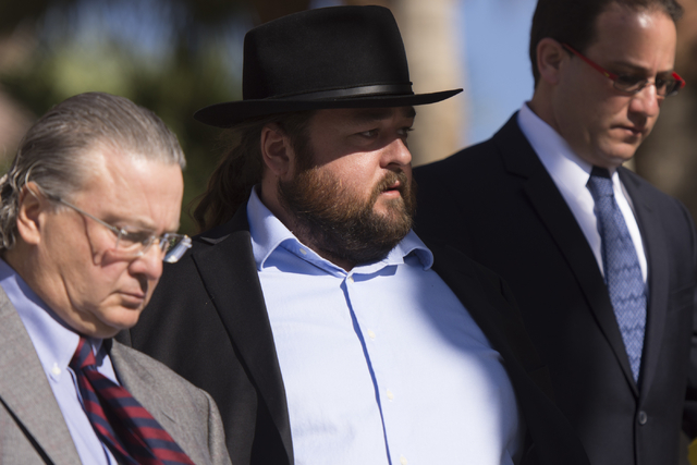 "Austin Lee ""Chumlee"" Russell, center, and his attorneys, leave the Regional Justice Center in Las Vegas Monday, May 23, 2016. The reality TV actor from ""Pawn Stars&q ..."