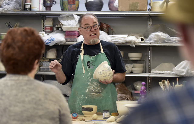 Clay Arts Vegas co-owner Thomas Bumblauskas demonstrates underglaze techniques during a workshop at the Main Street studio, home base for the artists represented in the current City Hall exhibit & ...