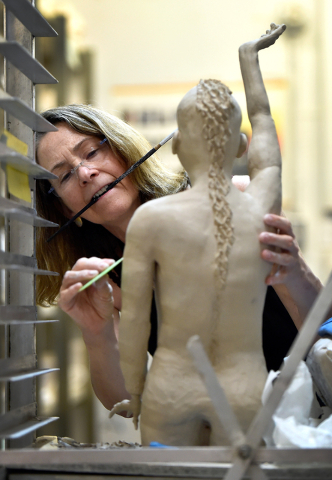 """At work on her clay figure """"Korangaikuta,"""" artist (and psychiatrist) Coni Kalinowski contributed to """"Cultural Triptych,"""" part of the """"Vegas to a Local& ..."""