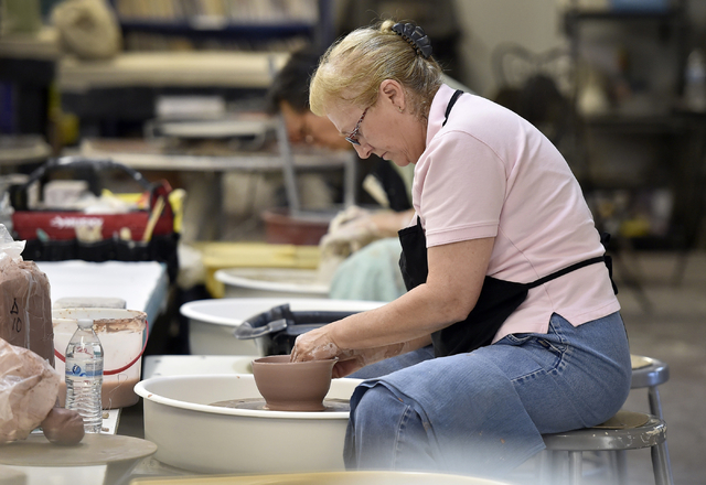 Laura Runco throws a bowl on a wheel at Clay Arts Vegas' Main Street studio. David Becker/Las Vegas Review-Journal Follow @davidjaybecker