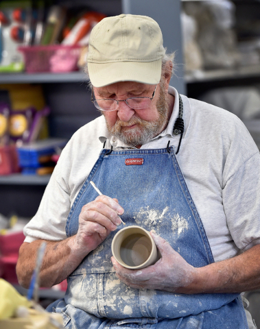 """One of the artists featured in the """"Vegas to a Local"""" exhibit at Las Vegas City Hall, Brian Ayriss preps a clay mug at the Clay Arts Vegas studio on Main Street. David Becker/Las ..."""