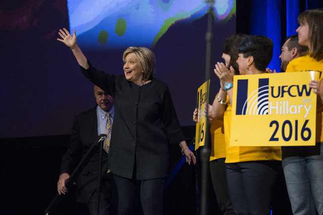 Democratic presidential candidate Hillary Clinton takes the stage before speaking during a United Food and Commercial Workers International Union convention meeting at the Mirage Convention Center ...