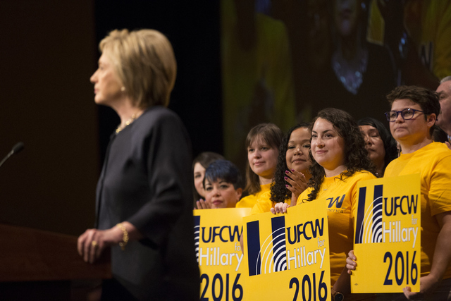 Supporters listen to Democratic presidential candidate Hillary Clinton speak during a United Food and Commercial Workers International Union convention meeting at the Mirage Convention Center on T ...
