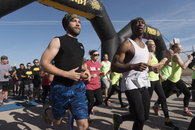 Runners cross the start line during the Badass Dash obstacle course event at Sam Boyd Stadium in Las Vegas on Saturday, May 28, 2016.  (Jason Ogulnik/Las Vegas Review-Journal)