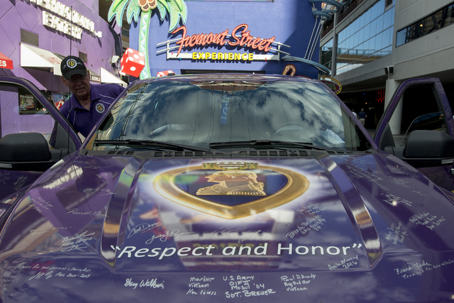 Military Order of the Purple Heart coordinator Joe Tidwell sits in the passenger seat with Marine Cpl. Tyler Huffman driving May 13, 2016 on Fremont Street in Las Vegas. (Bridget Bennett/Las Vegas ...