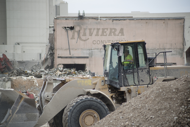 A worker drives a construction vehicle as crews work to demolish parts of the Riviera hotel-casino in Las Vegas on Friday, May 20, 2016. The two main towers are scheduled to be imploded in June an ...